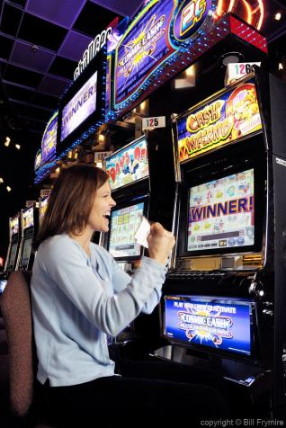 woman playing slot machines - gambling